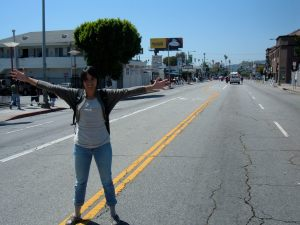 Adonia stretches her legs on an empty Hollywood Bl.
